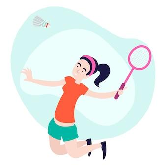 쾌활한 젊은 여자가 배드민턴 경기에서 점프