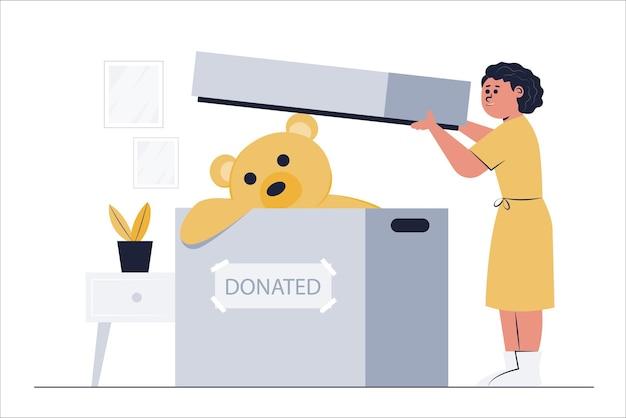 Уборщица собирает большого плюшевого мишку и отправляет его в питомник для пожертвований.