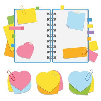 Цветной открытый блокнот на пружине с чистыми листами и закладками между страницами.