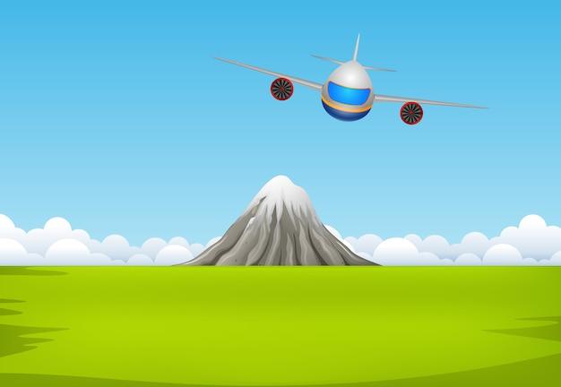 Коммерческий самолет, летящий над горой