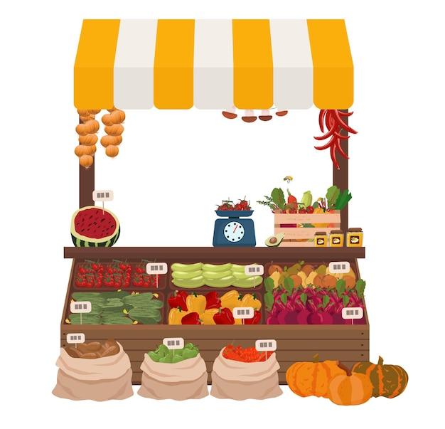 현지 시장에 캐노피가 있는 카운터, 야채, 과일, 꿀. 수확물의 판매.