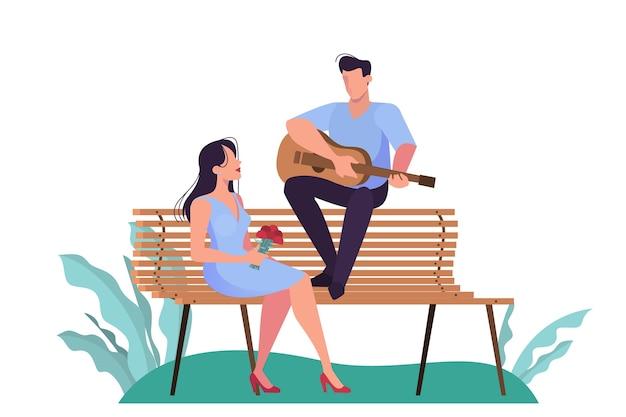 公園でデートをするカップル、ロマンチックな性格。女性のためのギターを弾く男。