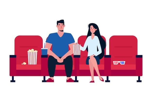 영화관에서 영화를 보고 팝콘을 먹는 커플