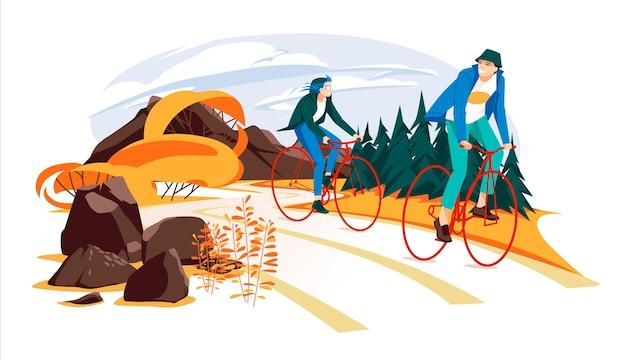 カップルが田舎道をサイクリングしている秋男と女は自由な時間を積極的に過ごす