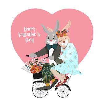 Влюбленная парочка кроликов на велосипеде с букетом цветов на фоне большого сердца