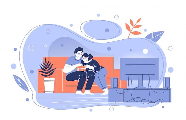 Пара смотрит 3d фильмы по телевизору у себя дома. парень и девушка с интересом смотрят фильм. проводить время. самоизоляция. оставайся дома.