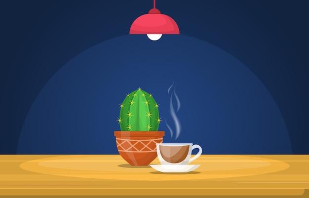 光ランプの図の下のテーブルで熱いお茶のカップ