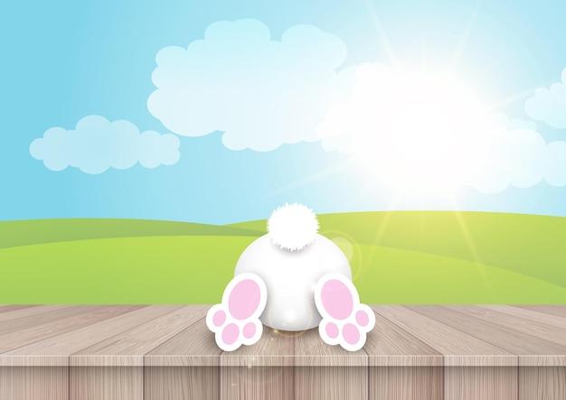 나무 테이블 배경에 귀여운 토끼