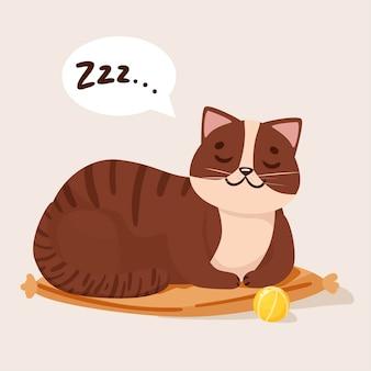 Милый кот спит на подушке рядом с иллюстрацией игрового мяча