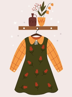 ハンガーに掛かっているかわいい韓国風の秋のドレス。花瓶との構成。廊下の部屋。