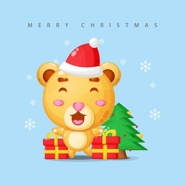 かわいいマスコットのクマがクリスマスを祝う