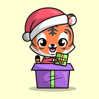 Милый тигр выходит из большой подарочной коробки и выглядите так счастливым