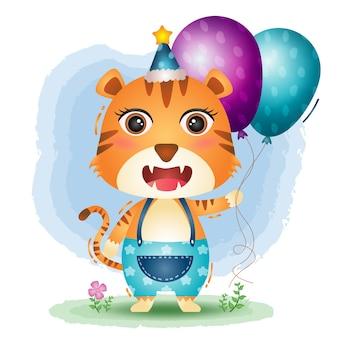 バースデーハットを使って気球を抱くかわいいトラ
