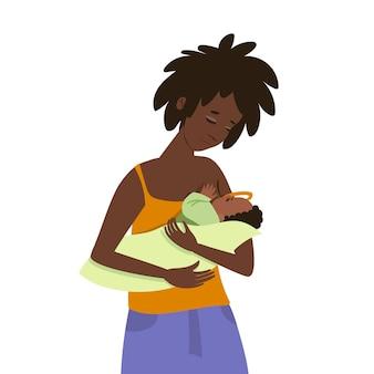 어두운 피부색의 젊은 여성이 아이에게 먹이를줍니다.