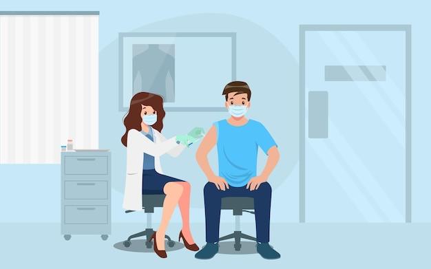 한 남성에게 코로나 바이러스 백신을 투여하는 병원의 의사. 면역 건강을위한 예방 접종 개념. 사람을위한 치료, covid-19에 대한 예방 접종에 대한 바이러스 예방.
