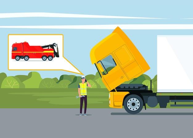 運転手が壊れたトラックの近くでレッカー車を呼び出します。