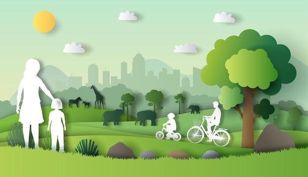 Семья наслаждается свежим воздухом в парке в окружении множества животных.