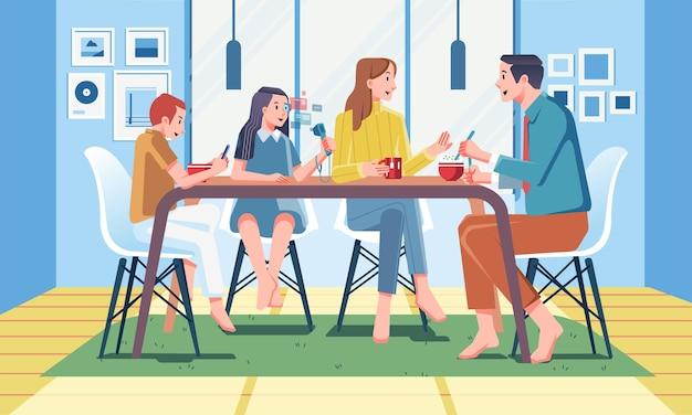 ダイニングルーのダイニングテーブルで一緒に朝食をとる家族
