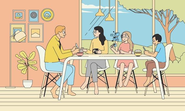 中庭を示す大きな窓のあるダイニングテーブルで一緒に朝食をとる家族