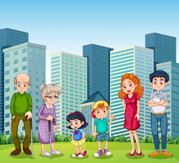 건물 앞에서 조부모님과 함께하는 가족