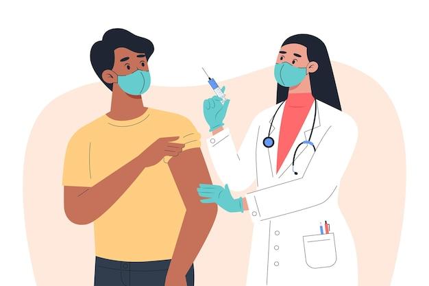 マスクと手袋をはめた女性医師が男性患者にワクチンを接種する