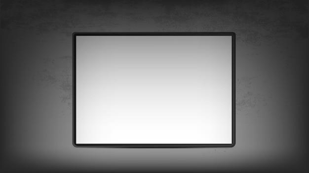 Белая картина в рамке висит на бетонной стене.