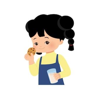 ビスケットと牛乳を食べる女の子。健康な概念と子供の栄養。白い背景の上。