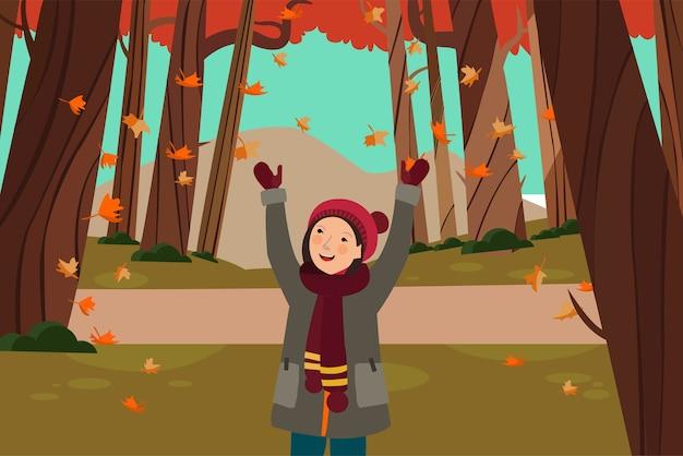 少女は秋の葉の滝を見て幸せ