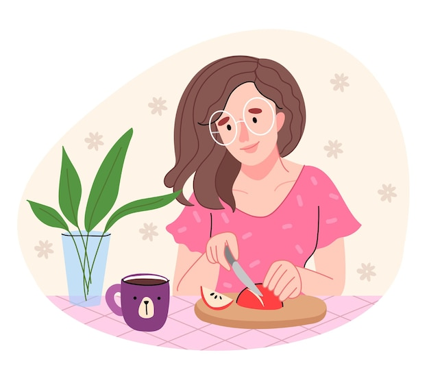 분홍색 셔츠를 입은 소녀가 부엌에서 요리를하고 있습니다. 둥근 안경에 여자는 사과 조각.