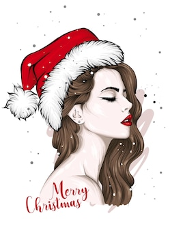 흰색 절연 산타 모자에 소녀