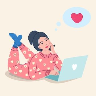 잠옷을 입은 한 소녀가 바닥에 누워 원격 통신을 위해 노트북을 사용하고 있습니다. 격리된 외로운 소녀는 발렌타인 데이에 잔치를 축하합니다. 현대 벡터 일러스트