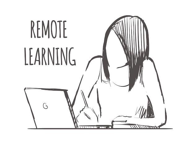 女の子はラップトップを使用してオンラインで学習します