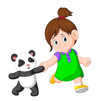 女の子はパンダの人形で遊ぶのが好きです