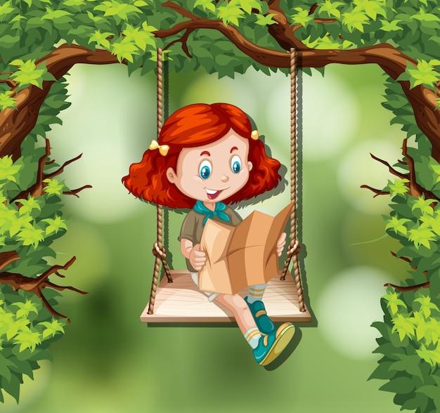 Девушка читает карту в джунглях