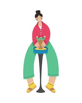 Девушка лепит глиняный горшок на гончарном круге. творческая деятельность.