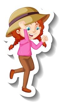 帽子の漫画のキャラクターのステッカーを身に着けている女の子