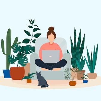 ノートパソコンを持った少女は、鉢植えの植物に囲まれた椅子に座っています。
