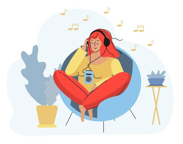 Девушка с плеером сидит в уютном кресле, слушает музыку. векторная иллюстрация.