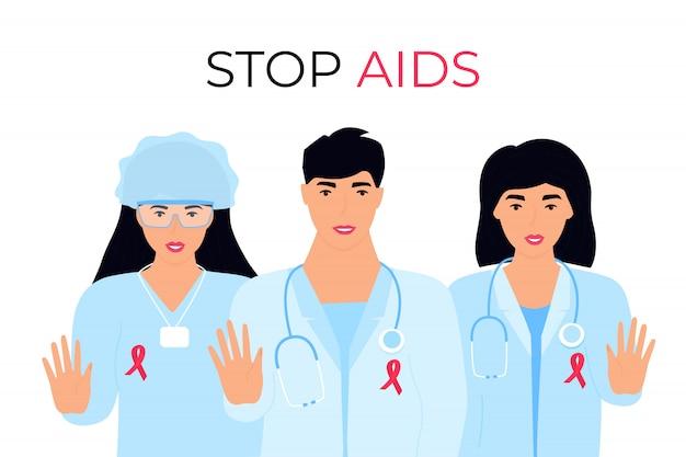 医療ガウンに赤いリボンをつけた医師のグループは、ストップエイズのジェスチャーを示しています。世界の性の健康の日。
