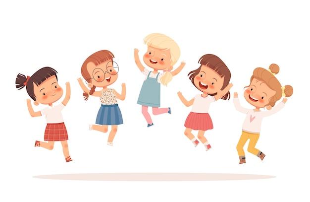 ジャンプして楽しんでいる楽しい女の子のグループ。白い背景で隔離。