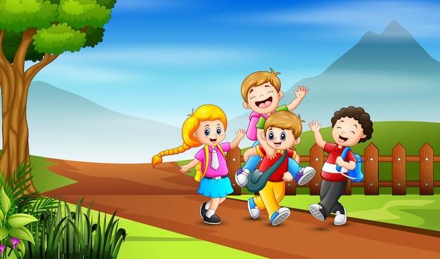 学校のイラストに行く子供のグループ