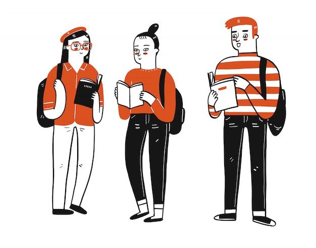 한 그룹의 학생이 책을 들고 서서 채팅을하고 있습니다.