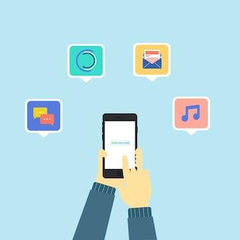 いくつかのアプリのアイコンが付いている電話を持っている手
