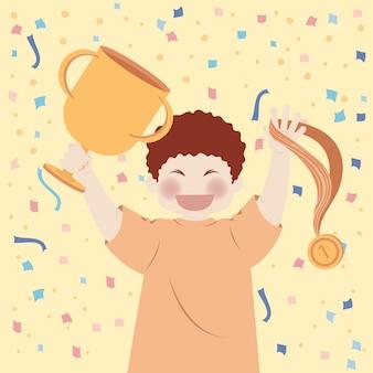 우승자 챔피언이되는 행복한 소년은 트로피와 메달을 보유합니다.