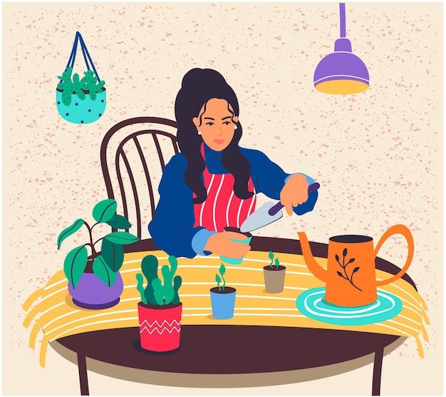 행복한 소녀는 화분에 심은 식물을 돌본다. 젊은 여성은 집에서 실내 식물을 키운다
