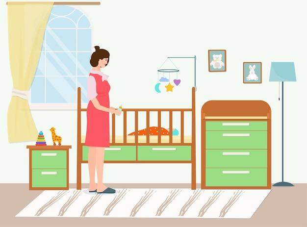 갓 태어난 아기와 함께 유아용 침대에서 젖병을 든 행복한 어머니. 어린이 침실의 인테리어입니다.