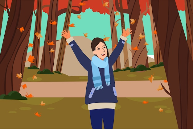 幸せな女性は、公園で自然な秋のシーズンを愛する