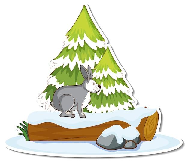 雪のステッカーで覆われた松の木のうさぎ