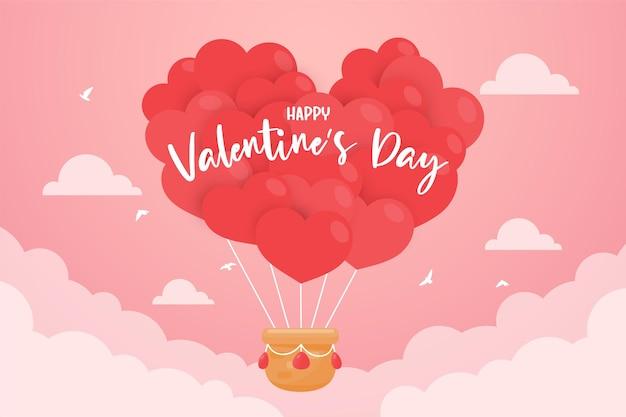 Воздушный шар-сердце, плывущий в небе с зелеными весами, чтобы подарить парам подарки на день святого валентина