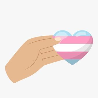 인간의 손은 트랜스젠더 색상의 심장을 보유하고 있습니다. 관용과 연대의 상징.